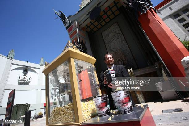 Theater Operations Manager Levi Tinker participates in the ribbon cutting for the re-opening of the TCL Chinese Theater forecourt at TCL Chinese...
