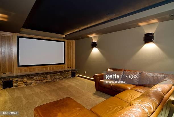 Theater room with large cushion U shape sofa