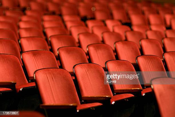 theater seats in an empty auditorium - seat stock pictures, royalty-free photos & images