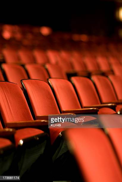 theater seats in an empty theater - broadway manhattan stock photos and pictures