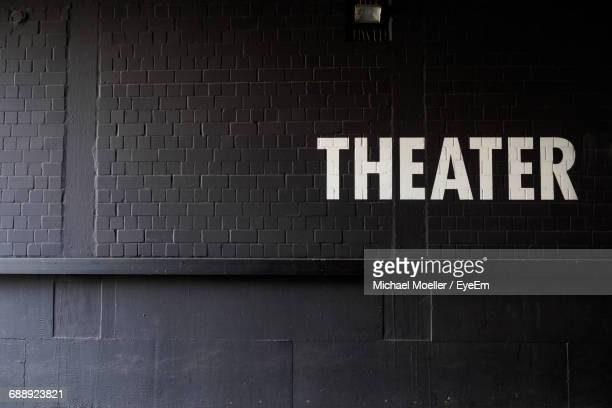 Theater Text On Black Wall