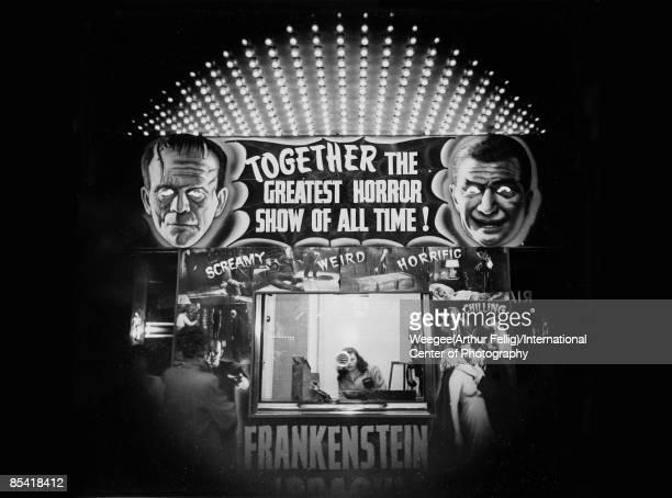 A theater ticket booth advertises Frankenstein and Dracula in 'The Greatest Horror Show of All Time' 1940 Photo by Weegee/International Center of...