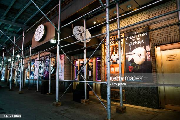Theaters are seen closed at Times Square on August 8 2020 in New York City With more than four months NYC has closed some of their doors to combat...