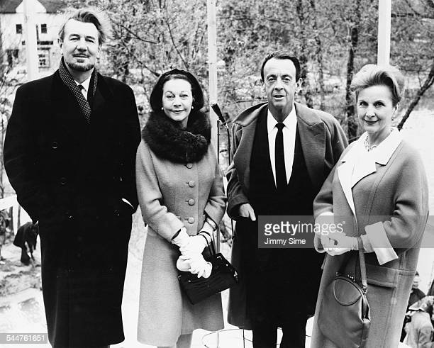 Theatre actors Michael Redgrave Vivien Leigh Robert Helpmann and Diana Wynyard viewing the under construction site of the Yvonne Arnaud Theatre...