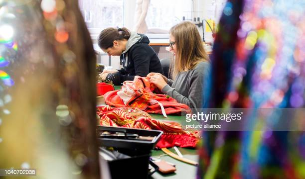 Theatre costume seamstresses Ursula Blaettler and Silvia Kaletha sewing clothes in the costume workshop for Disney musical Aladdin in Hamburg Germany...