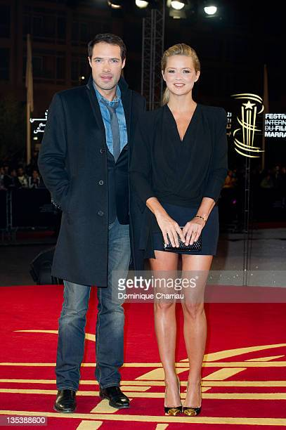 Theatre director/actor Nicolas Bedos poses with actress/TV presenter Virginie Efira as they arrive at the'Miss Bala' Red Carpet Photocall during...