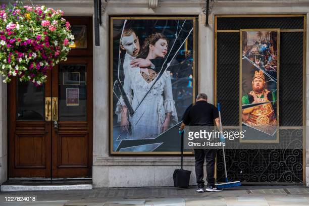 Theatre employee cleans the street outside Her Majestys Theatre, home to Phantom of the Opera, on July 29, 2020 in London, England. Phantom of the...