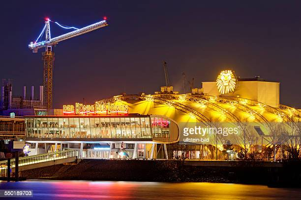 theatre for the musical 'the king of the lions' at night in Hamburg harbour at river Elbe