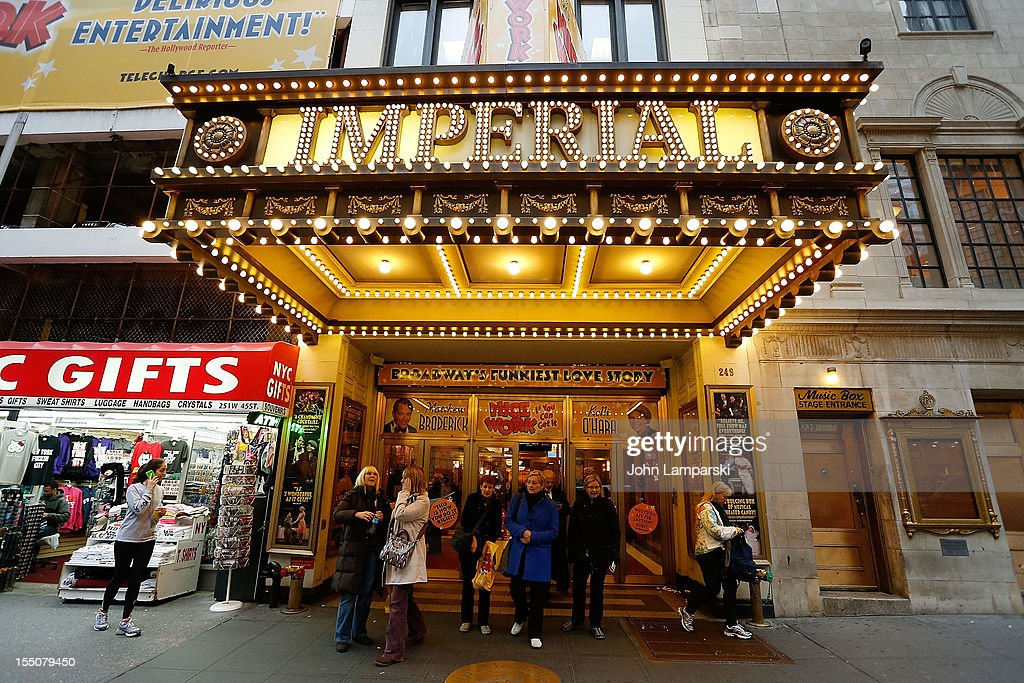 Theatre goers are seen exiting a Broadway show in Times Square following Hurricane Sandy on October 31, 2012 in New York City.