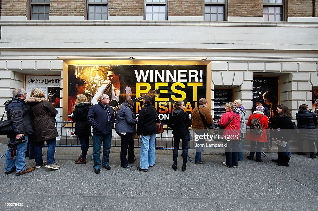 Theatre goers stand in line to have autographes signed after a Broadway show in Times Square following Hurricane Sandy on October 31, 2012 in New York City.