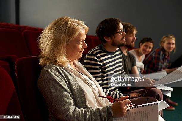 Theatre group attending rehearsal.