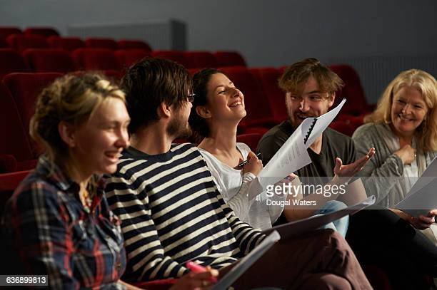 Theatre group discussing script.