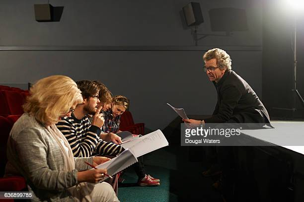 theatre group reading and discussing script. - actress stock pictures, royalty-free photos & images