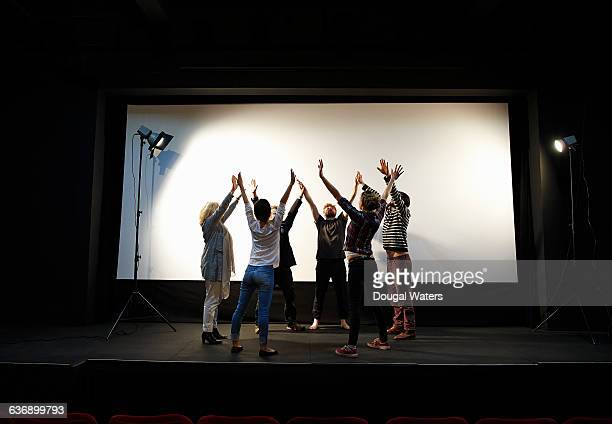 Theatre group rehearsing on stage.