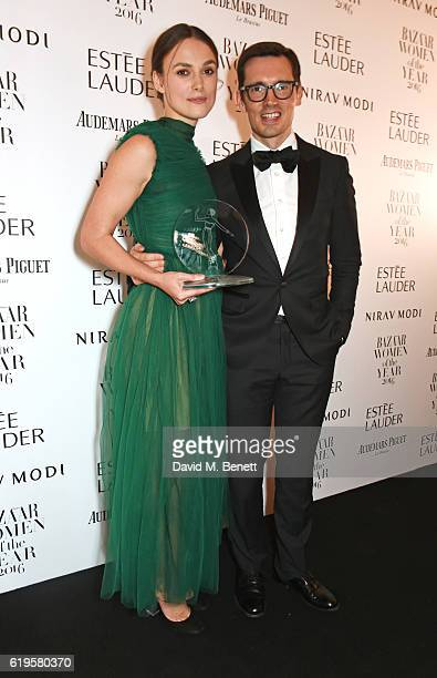 Theatre Icon award winner Keira Knightley and presenter Erdem Moralioglu attend the Harper's Bazaar Women of the Year Awards 2016 at Claridge's Hotel...