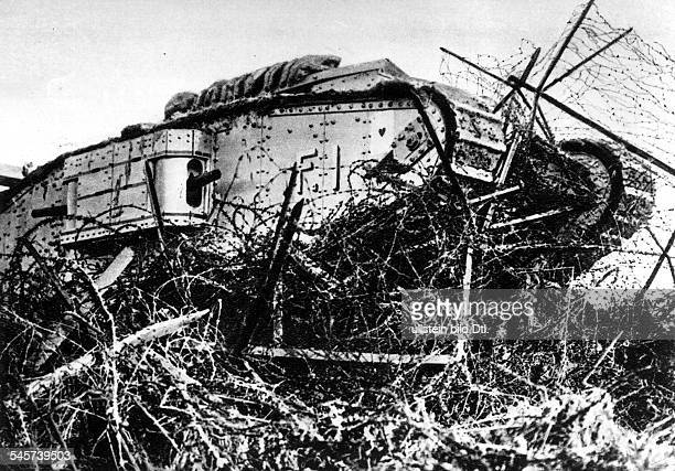 1WW Theatre of war Tank battle of Cambrai 20Nov15Dec1917 British mark IV tank during an attack operation Breaking through a barbed wire barrier Nov...