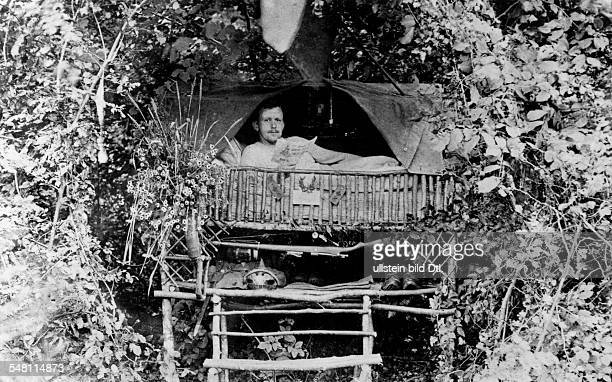 1WW Theatre of war western front 1915 'Idyll' in a grove behind combat zone Soldier resting in his 'Villa Hildegard' no further details summer 1915