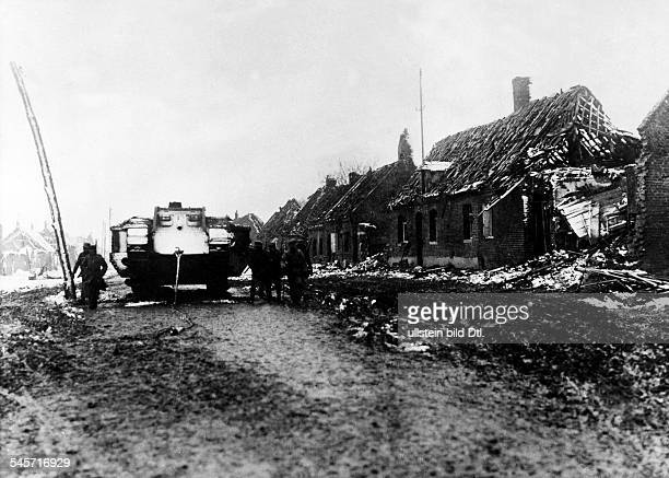 1WW Theatre of war western front 1917 Battle of Cambrai 2011 After the german counterattack An abandoned british Mark IV tank and german soldiers in...