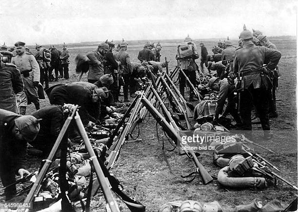 Theatre of war , western front : Belgium-France august-september1914 :German soldiers after a short rest continue their advance toward the Marne -end...