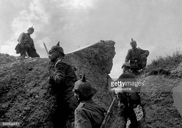 1WW Theatre of war western front BelgiumFrance augustseptember1914 Conquest of Liege august 14th German soldiers inspecting one of the totally...