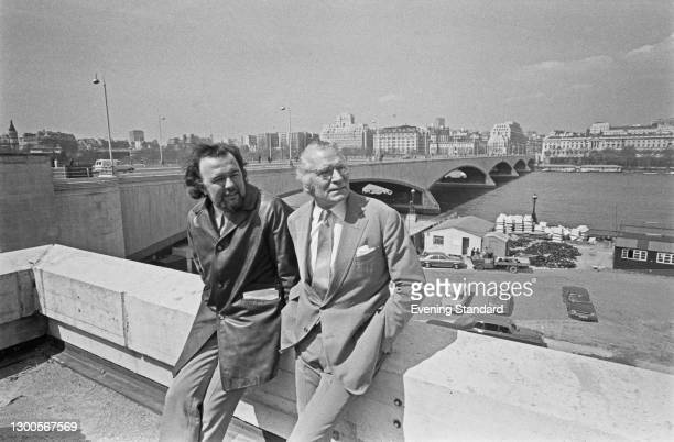 Theatre, opera and film director Sir Peter Hall with actor, producer and director Sir Laurence Olivier on the terrace of the National Theatre in...
