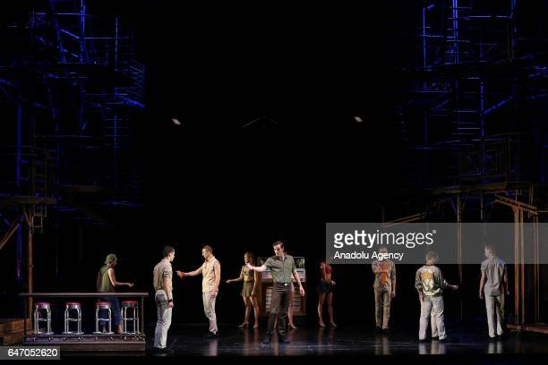 """Theatre players perform on the stage of American musical """"West Side Story"""" for the press members in Zorlu Performing Art Center in Istanbul, Turkey..."""
