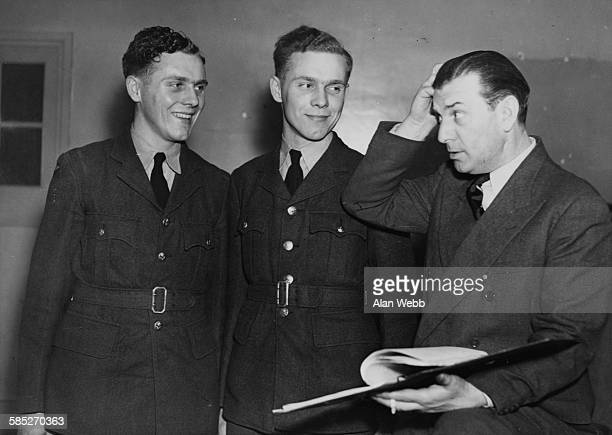 Theatre producer Ralph Reader directing Royal Air Force twins Derek and Kenneth Allen during rehearsals for a recruiting show April 2nd 1947