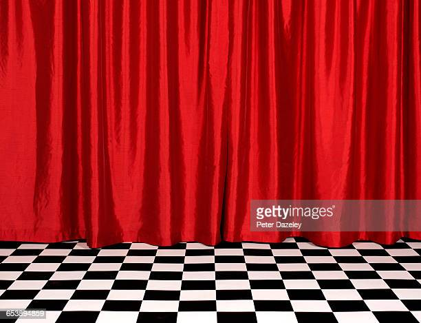 theatre red curtains with chequered floor - silk stock pictures, royalty-free photos & images