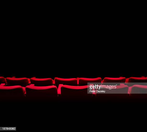 theatre seats facing a dark stage or screen - film industry stock pictures, royalty-free photos & images