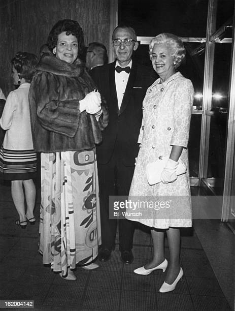 MAY 9 1968 MAY 10 1968 Theatregoers await curtain bell Mrs William E Sweet Jr left and Mr and Mrs Clark Gittings wait in foyer for curtain bell at...