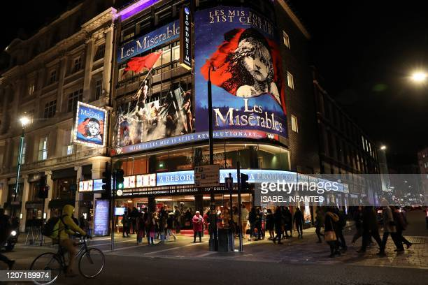 "Theatre-goers for an evening show of ""Les Miserables"" at Queen's Theatre on March 12, 2020 in the theatres and restaurants district of West End in..."