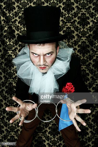 theatrical magician ring trick - con man stock photos and pictures