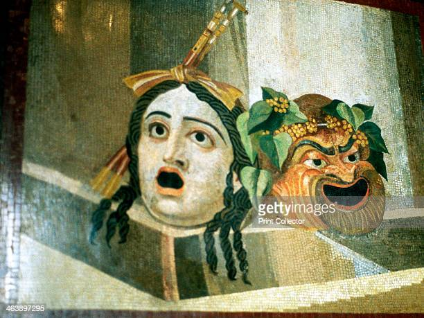 Theatrical masks of tragedy and comedy depicted in a Roman mosaic.