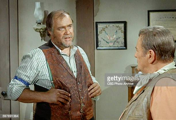 LOBO theatrical movie originally released December 18 1970 Film directed by Howard Hawks Pictured left to right David Huddleston and John Wayne Image...