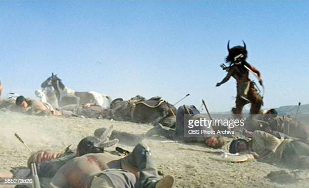 MAN theatrical movie originally released December 23 1970 The film directed by Arthur Penn Pictured Cal Bellini approaches among the dead and wounded...