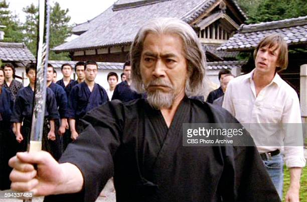 CHALLENGE theatrical movie originally released July 23 1982 The film directed by John Frankenheimer Pictured Toshiro Mifune with a sword Behind him...