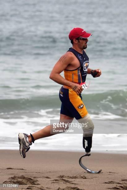 P Theberge runs on the beach during the Escape from Alcatraz Triathlon on June 4 2006 in San Francisco California