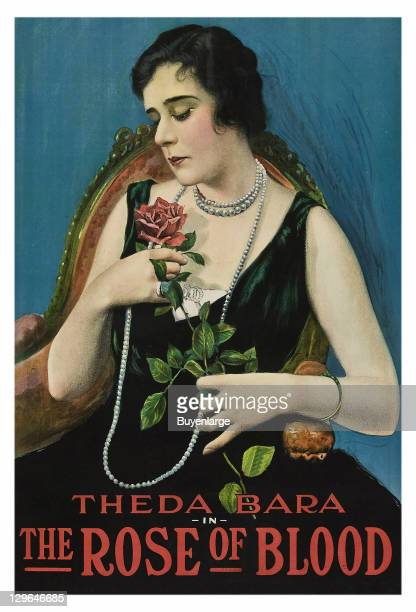 Theda Bara holds a rose on a poster that advertises the movie 'The Rose of Blood' 1917
