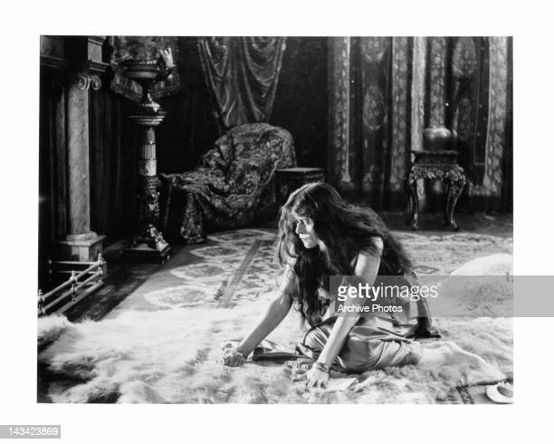 Theda Bara sitting on fur rug in a scene from the film 'A Fool There Was' 1915