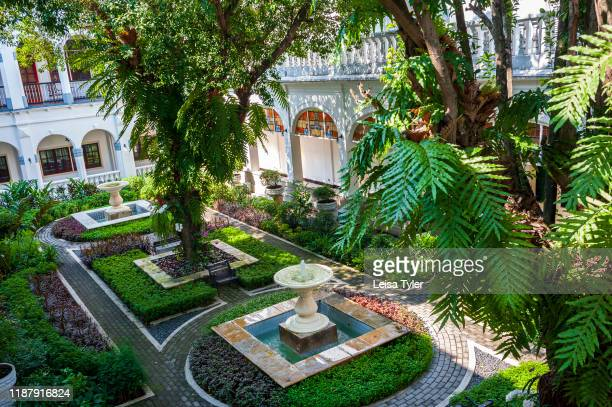 Thee gardens of the Hotel Majapahit, a historical hotel built by the Sarkies Brothers in 1910, Surabaya, Java, Indonesia. The Sarkies Brothers also...
