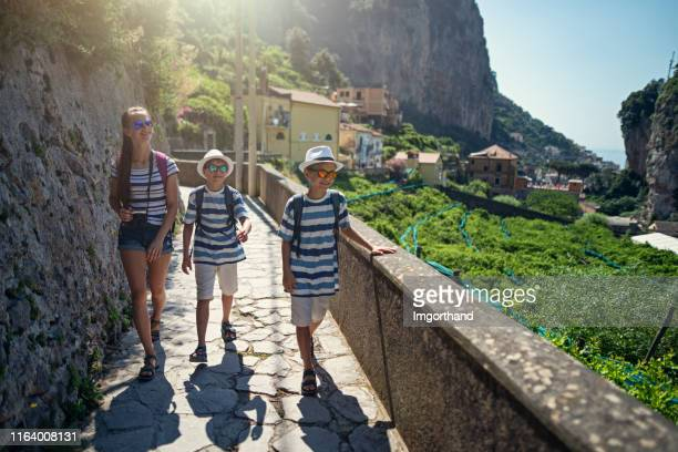 thee kids hiking from amalfi to mountains - campania stock pictures, royalty-free photos & images