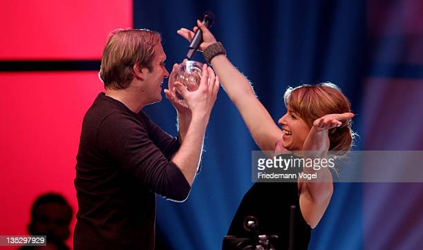 Thees Uhlmann receives the PlanB Award from Sabine Heinrich during 1Live Krone at the Jahrhunderthalle on December 8 2011 in Bochum Germany