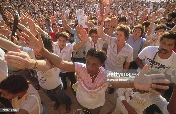 Their arms stretched to the sky delegates from the ecclesial base communities of Liberation Theology come together for their sixth meeting generating...
