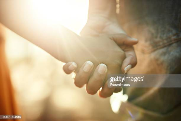 their bond is too precious - holding hands stock pictures, royalty-free photos & images