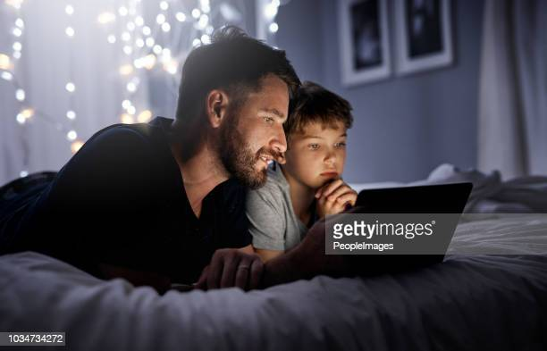 their connection runs day and night - bedtime stock pictures, royalty-free photos & images