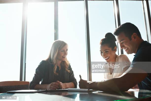their financial future is looking bright - financial advisor stock photos and pictures