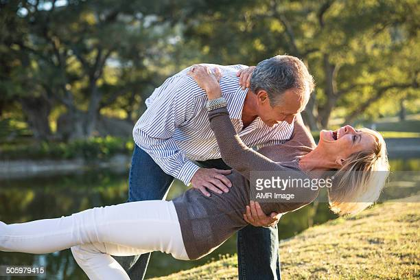 their love keeps them young at heart! - heterosexual couple stock pictures, royalty-free photos & images