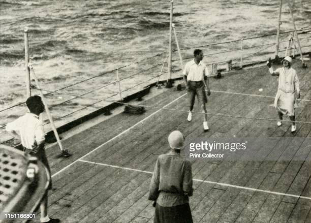 """Their Majesties, in a Game of Deck Quoits on Deck of H.M.S. """"Renown"""", 1927', 1937. His Royal Highness The Duke of York 1920-1936 became King George..."""