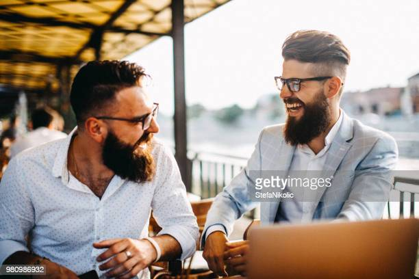 their moments after work - beard stock pictures, royalty-free photos & images