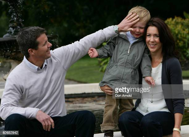 Their Royal Highnesses Crown Prince Frederik Crown Princess Mary and Prince Christian of Denmark pose during a media call at Government House on...